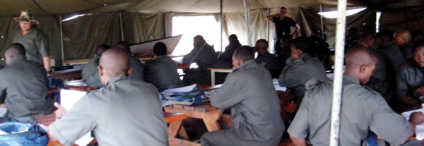 Rangers attend class in tented classrooms. The camp simulates living in the bushveld.
