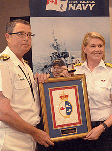 June 2016 –  Commissioner Jody Thomas presents a CCG Commendation to outgoing Royal Canadian Navy ­Commander Mark Norman.
