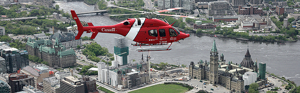 CCG 429 helicopter flies over Parliament Hill in Ottawa.