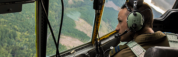 Captain Matt Adam steers his CC-130 Hercules aircraft from 435 Squadron in a tight orbit around the ground target during in SAREX 15, in Comox, British Columbia on September 14, 2015.